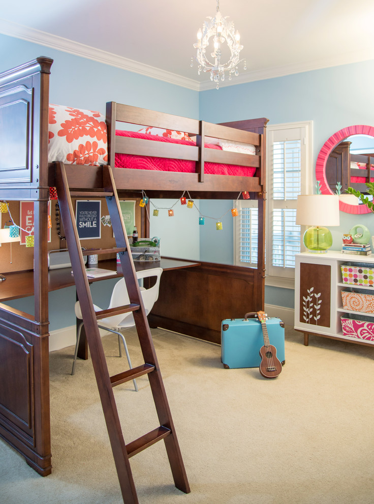 Inspiration for a transitional girl carpeted kids' room remodel in Raleigh with blue walls