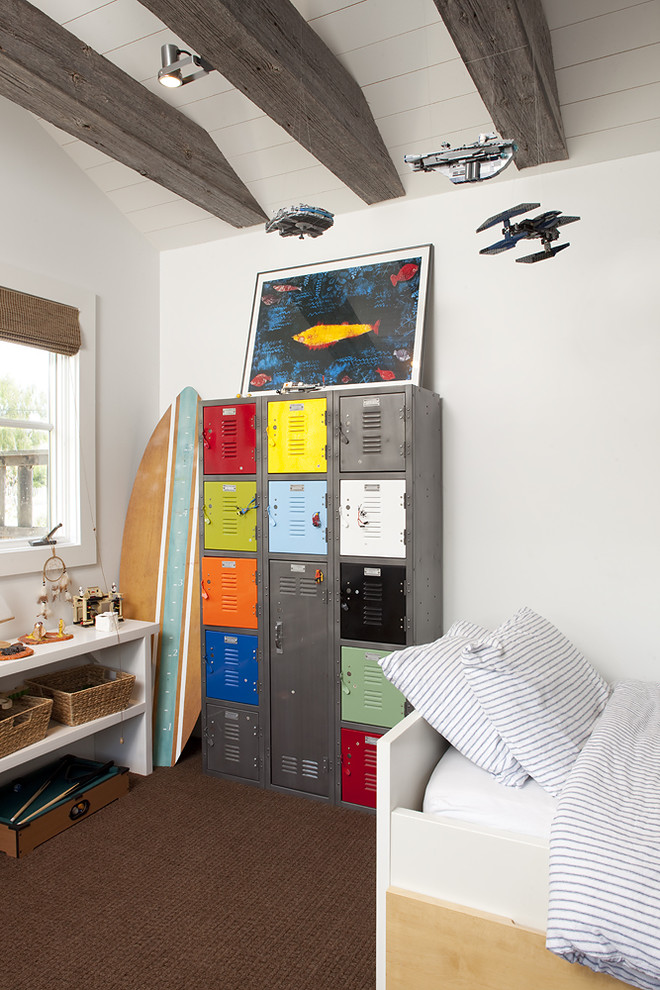 Example of a trendy boy carpeted kids' room design in San Francisco with white walls
