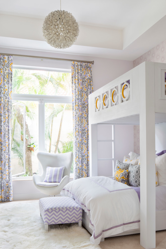 Kids' room - mid-sized contemporary girl carpeted kids' room idea in Miami with purple walls