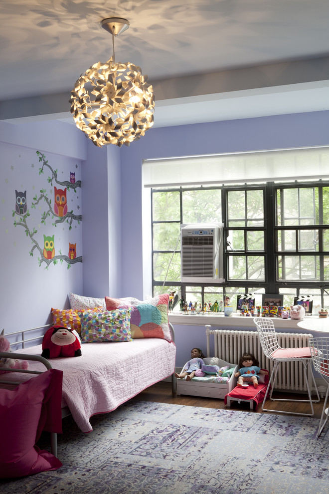 Kids' room - contemporary kids' room idea in New York with purple walls