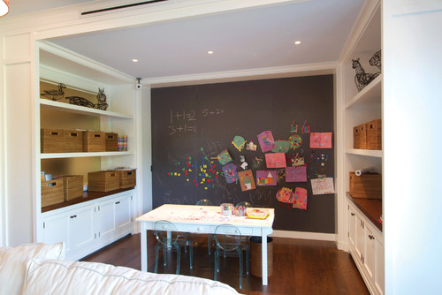 Nook with table and chairs, chalkboard wall and cabinets for storage