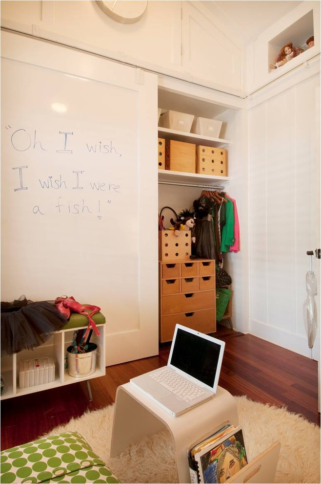 Kids' room - contemporary girl dark wood floor kids' room idea in Hawaii with white walls