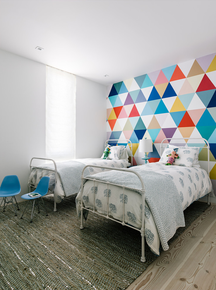 Inspiration for a contemporary gender-neutral light wood floor kids' room remodel in San Francisco with multicolored walls