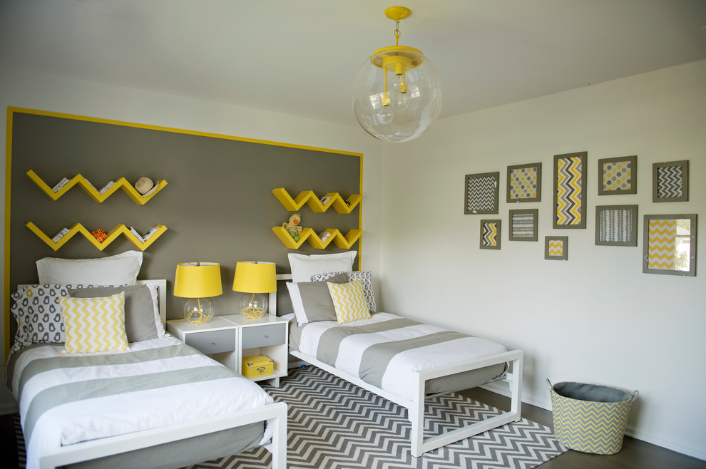 Inspiration for a contemporary gender-neutral dark wood floor kids' room remodel in New York with multicolored walls