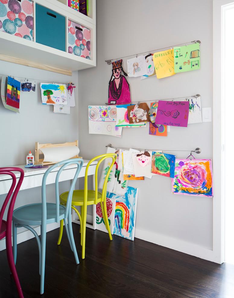 Kids' room - small contemporary gender-neutral dark wood floor kids' room idea in Dallas with gray walls