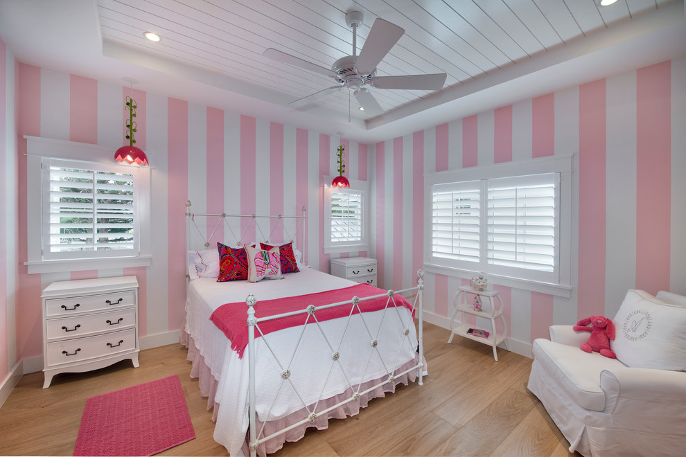 Example of a beach style girl light wood floor kids' room design in Miami with multicolored walls
