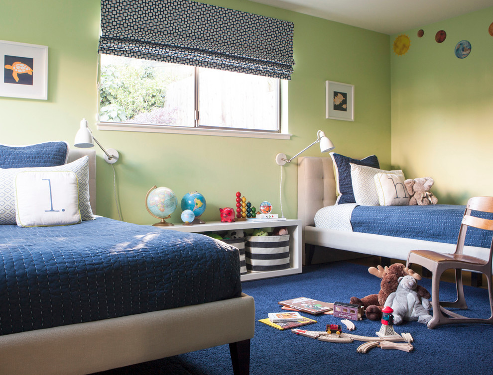 Example of a mid-sized trendy boy medium tone wood floor kids' bedroom design in San Francisco with green walls