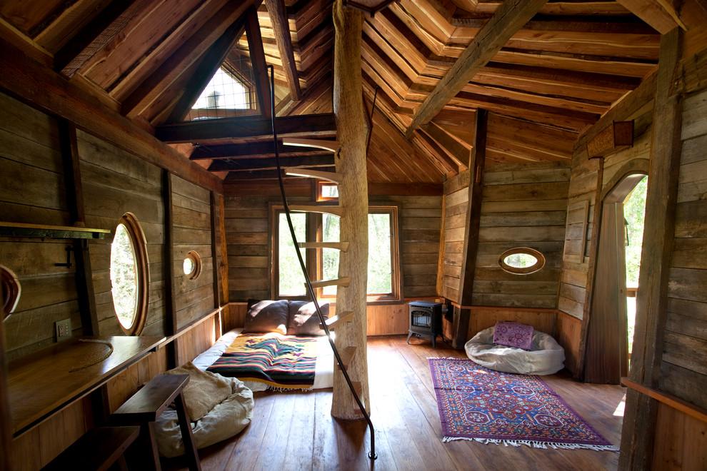 Example of a mountain style gender-neutral medium tone wood floor kids' bedroom design in Denver