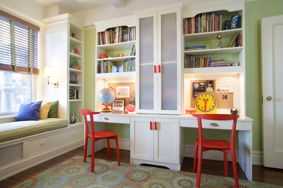 Example of a mid-sized transitional boy medium tone wood floor kids' room design in New York with green walls