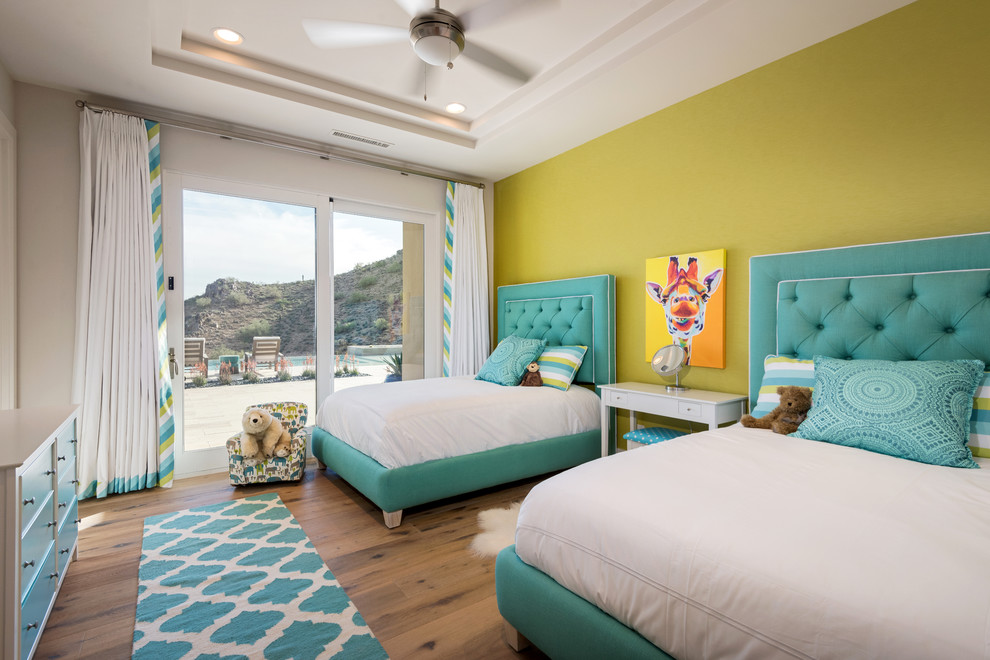 Example of a transitional light wood floor kids' bedroom design in Phoenix with multicolored walls