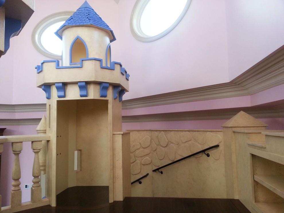 Kids' room - large eclectic girl dark wood floor kids' room idea in Las Vegas with pink walls