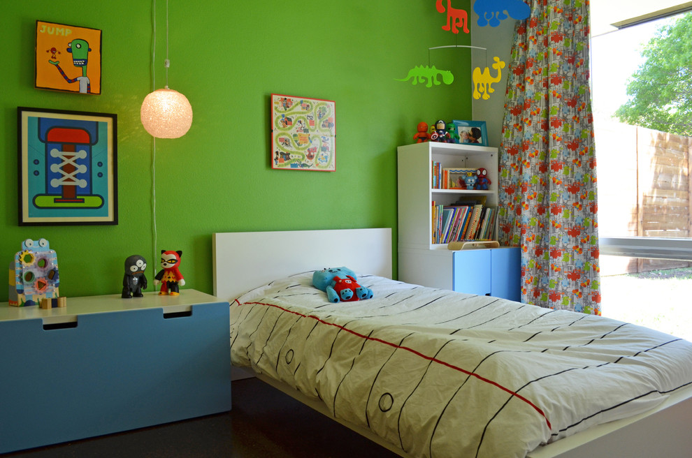 Example of a mid-century modern boy kids' room design in Dallas with green walls