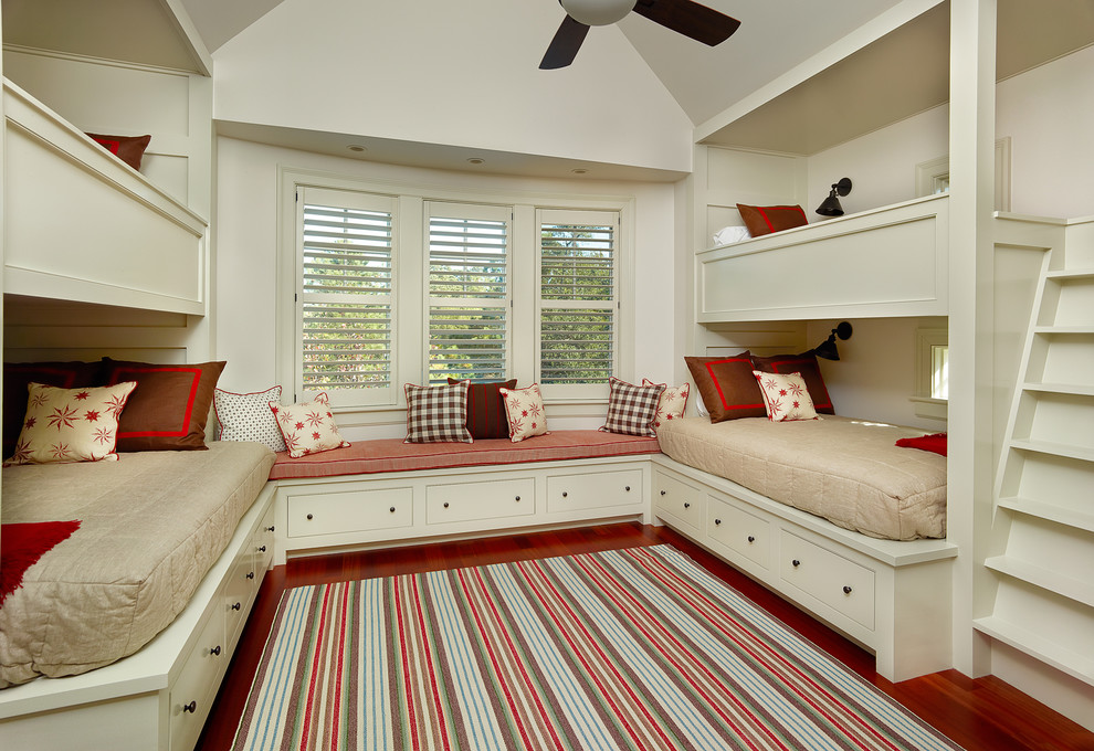Kids' room - traditional gender-neutral medium tone wood floor kids' room idea in Charleston with beige walls