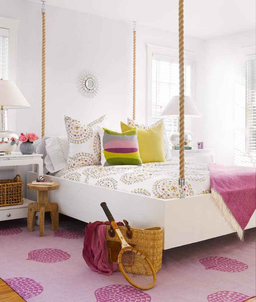 Mid-sized beach style girl kids' room photo in Boston with white walls