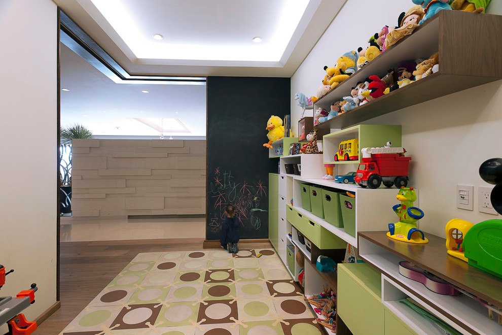 Example of a trendy gender-neutral medium tone wood floor kids' room design with white walls