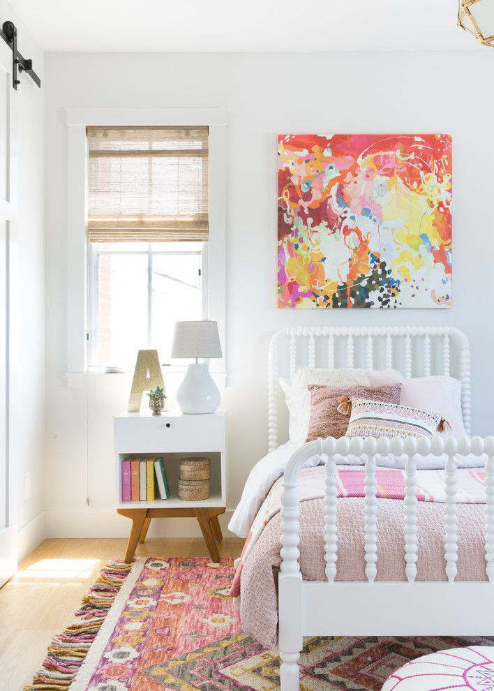 Mid-sized farmhouse girl light wood floor kids' room photo in San Francisco with white walls