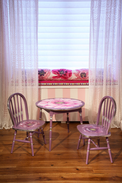 Example of a mid-sized eclectic girl medium tone wood floor kids' room design in New York with pink walls