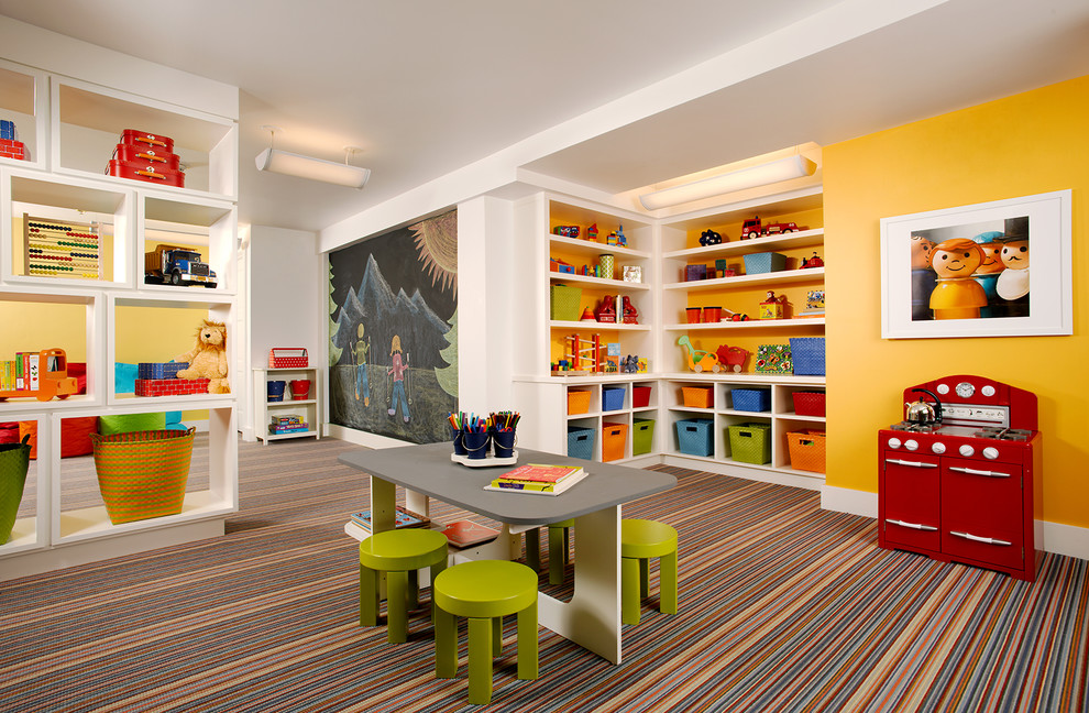 Playroom - large traditional gender-neutral carpeted and multicolored floor playroom idea in Denver with yellow walls