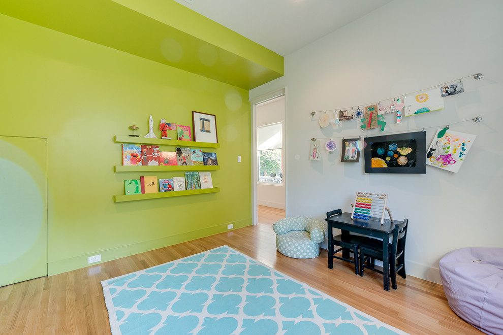 Example of a trendy playroom design in Dallas with green walls