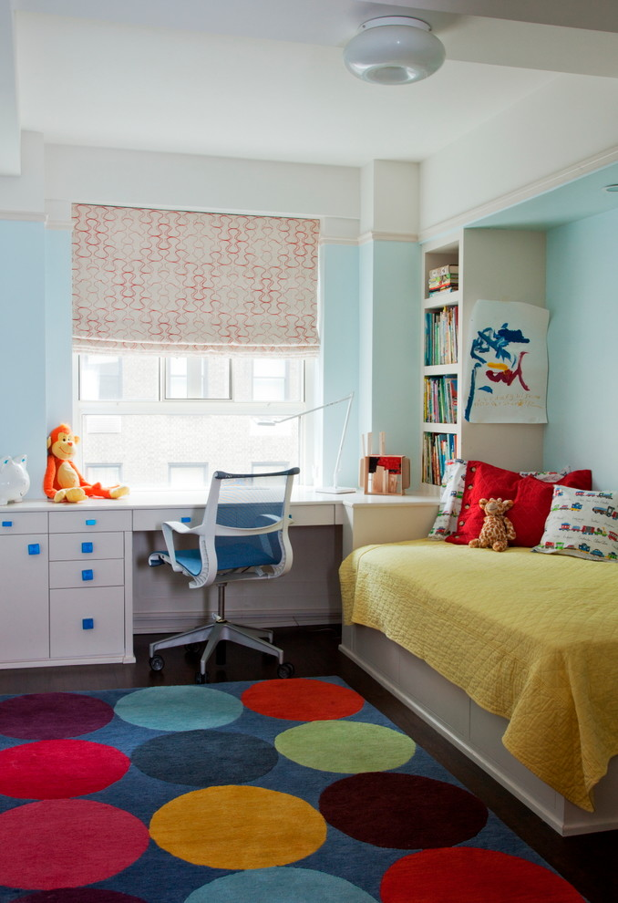Small transitional gender-neutral kids' room photo in New York with blue walls