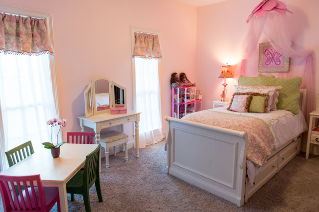 Mid-sized trendy girl carpeted kids' room photo in New Orleans with pink walls