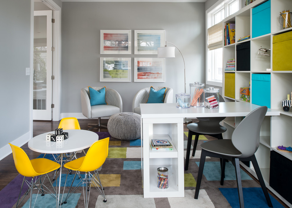 Transitional gender-neutral kids' study room photo in Minneapolis with gray walls