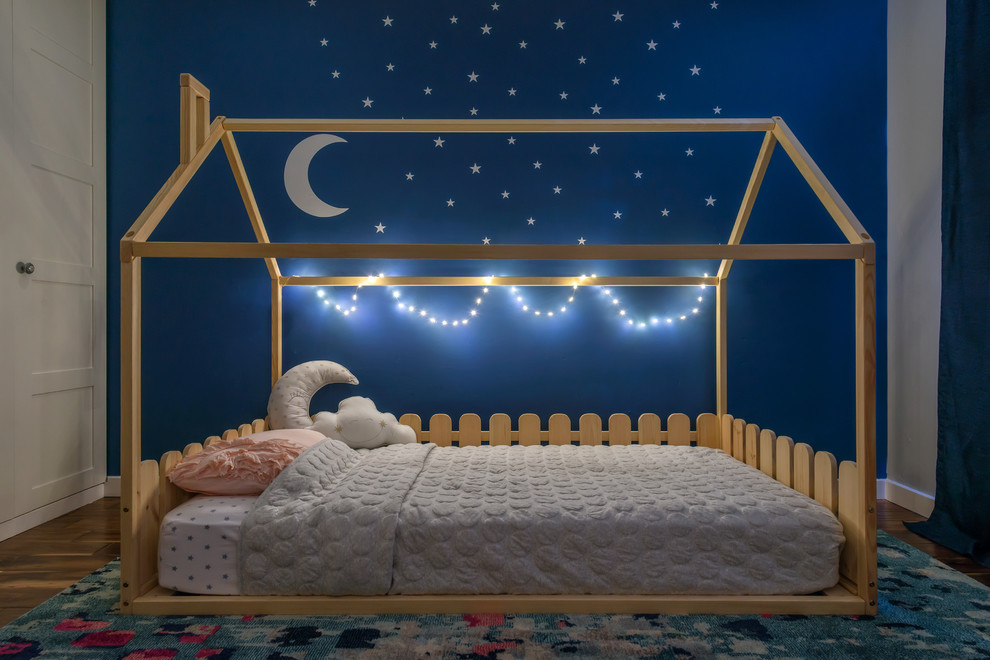 Mid-sized transitional girl medium tone wood floor kids' room photo in San Francisco with blue walls