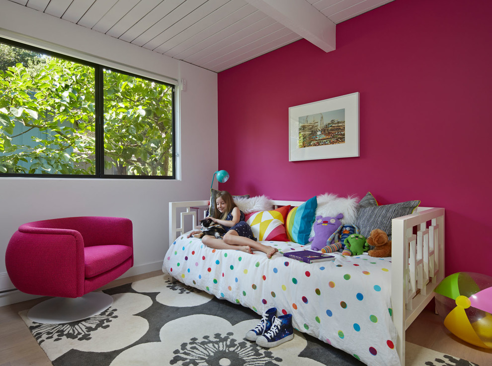 Kids' room - mid-century modern girl light wood floor kids' room idea in San Francisco with multicolored walls