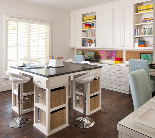 craft room with large craft table and lots of cabinets