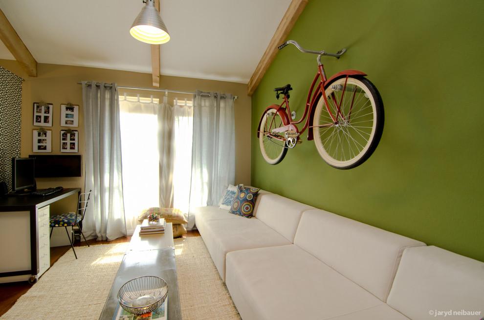 Mid-sized eclectic gender-neutral medium tone wood floor kids' room photo in Phoenix with green walls