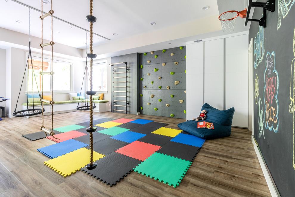 Huge trendy gender-neutral dark wood floor and brown floor kids' room photo in Seattle with black walls