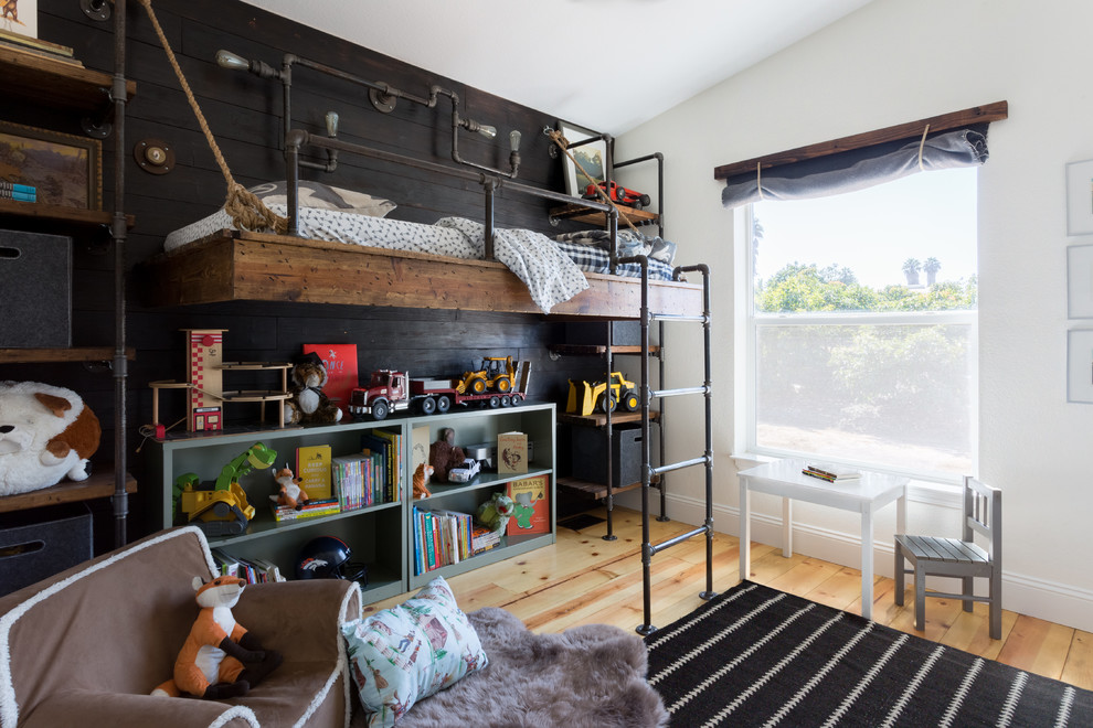 Inspiration for a mid-sized farmhouse boy light wood floor kids' room remodel in Santa Barbara with white walls
