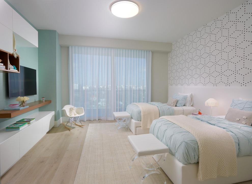 Example of a large trendy gender-neutral light wood floor and beige floor kids' bedroom design in Miami with blue walls