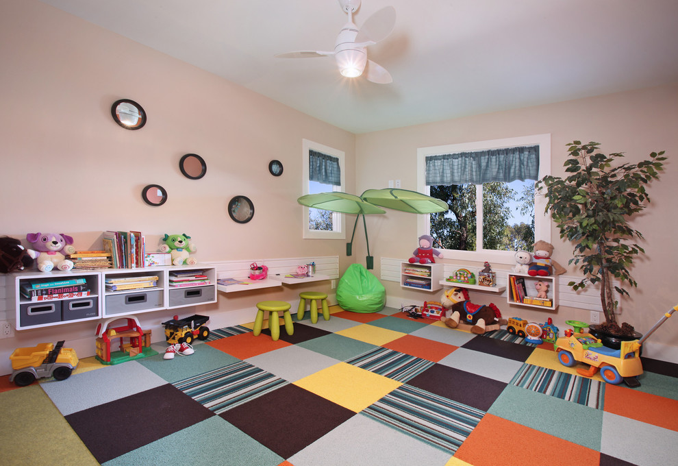 Trendy carpeted and multicolored floor playroom photo in Salt Lake City with pink walls