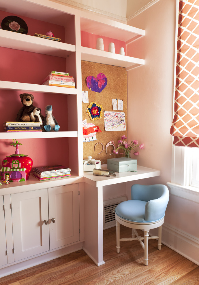 Example of a classic girl medium tone wood floor kids' room design in San Francisco with pink walls
