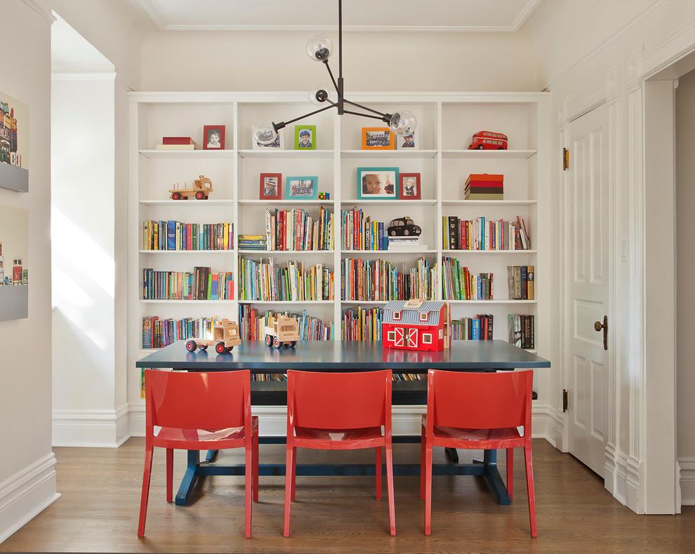 Kids' room - transitional gender-neutral medium tone wood floor kids' room idea in Chicago with beige walls