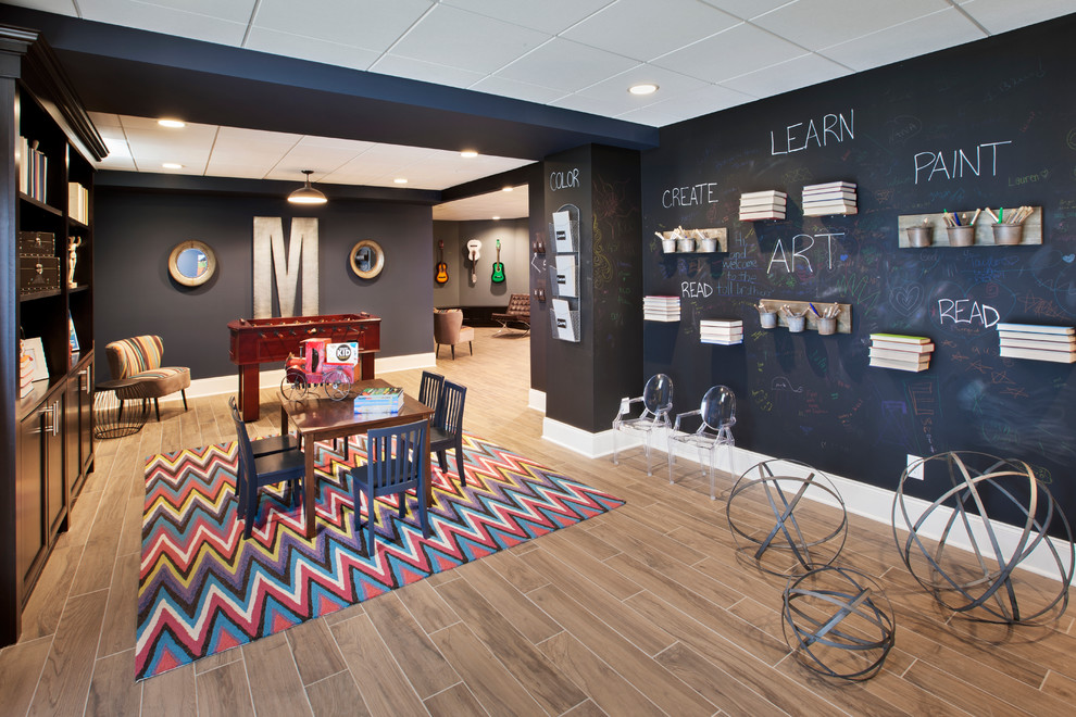 Example of a large transitional gender-neutral brown floor and porcelain tile playroom design in Detroit with black walls