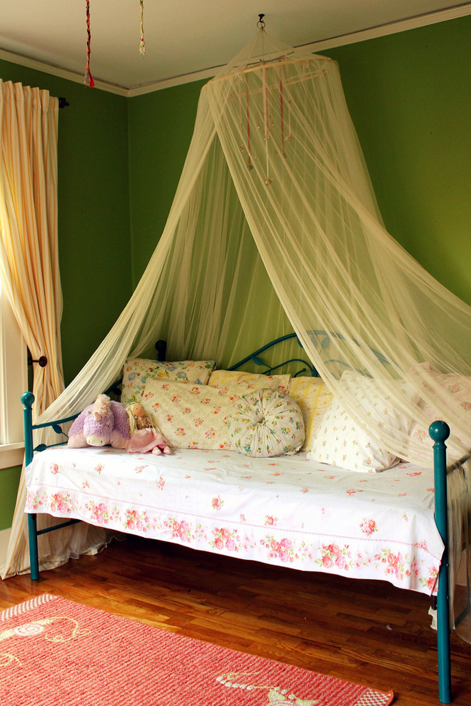Example of a cottage chic girl kids' room design in Albuquerque with green walls