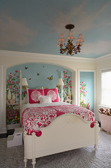 Girls bedroom with artist painted walls, sky ceiling, and fiber optic stars. traditional kids