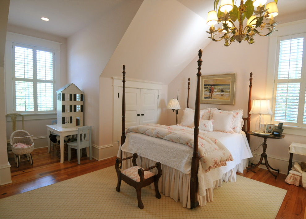 Kids' room - traditional girl medium tone wood floor kids' room idea in Charleston with white walls