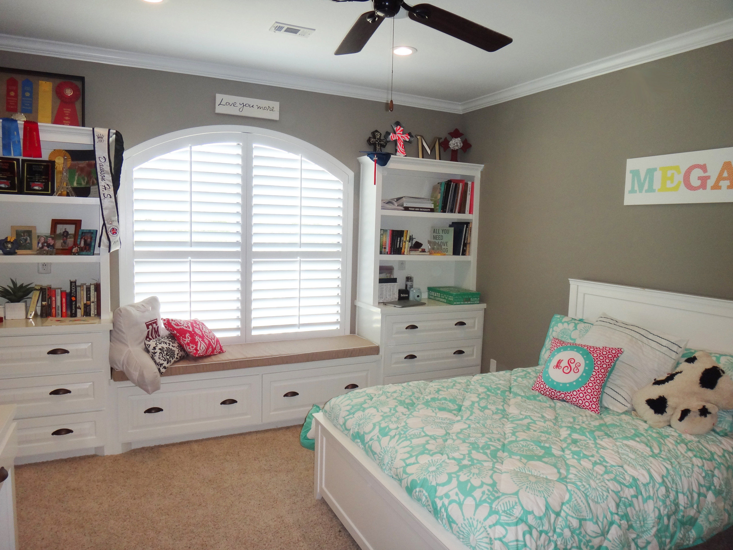 Girl's room with window seat and shelves