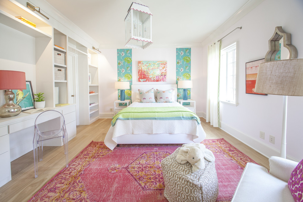 Kids' room - transitional girl light wood floor kids' room idea in Charlotte with white walls