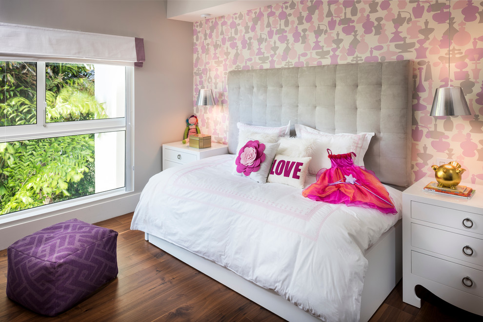Example of a mid-sized trendy girl dark wood floor kids' bedroom design in Miami with multicolored walls