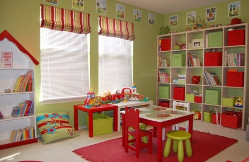 red and green playroom with organized bookshelf and clean tables