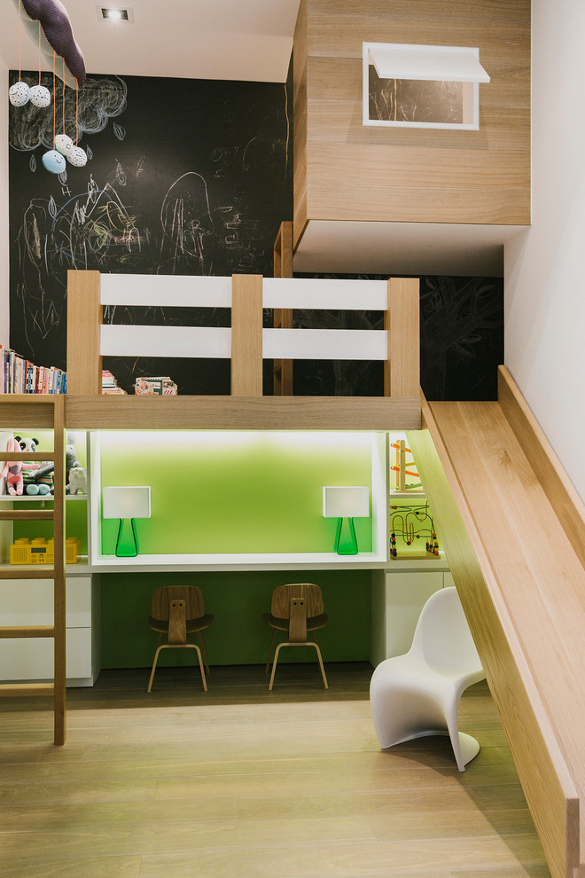 Inspiration for a large contemporary gender-neutral light wood floor and beige floor playroom remodel in New York with black walls
