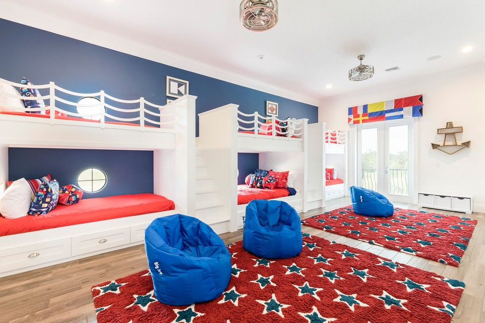 Example of a beach style gender-neutral light wood floor kids' room design in Orlando with white walls