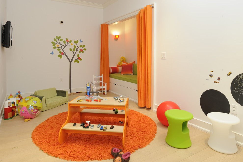 Inspiration for a mid-sized contemporary gender-neutral light wood floor kids' room remodel in New York with white walls