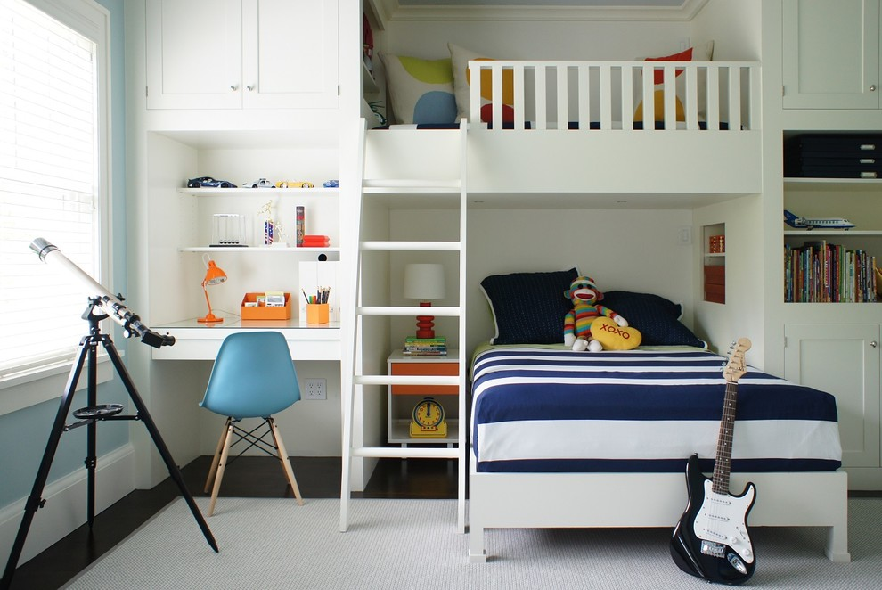 Kids' room - mid-sized contemporary gender-neutral dark wood floor kids' room idea in New York with white walls