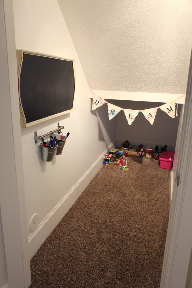 Kids' room - mid-sized traditional gender-neutral carpeted kids' room idea in Salt Lake City with white walls
