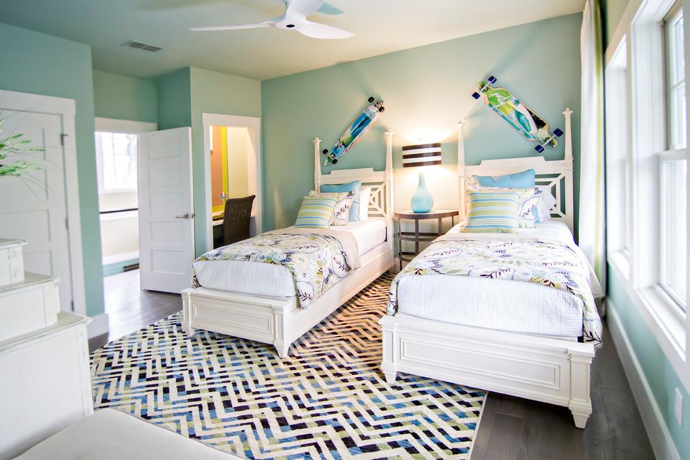 Example of a large island style gender-neutral dark wood floor and brown floor kids' room design in Jacksonville with blue walls
